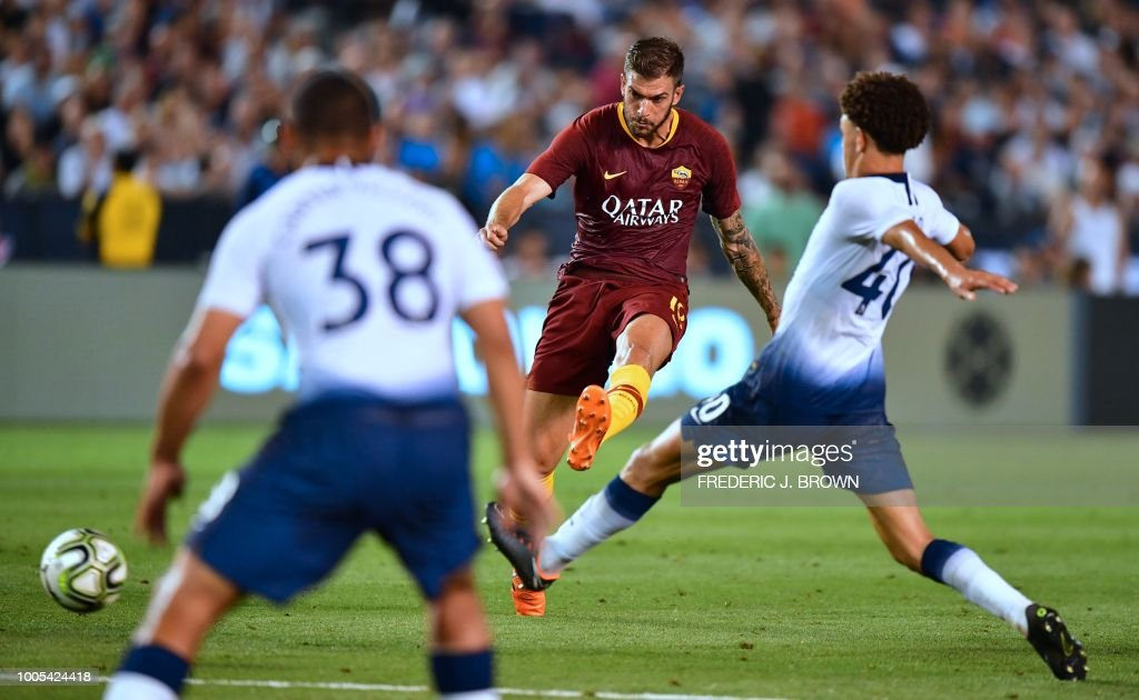 Davide Santon (C) of AS Roma shoots under pressure from Luke Amos (R) and Cameron Carter-Vickers (L) of Tottenham Hotspur during their International Champions Cup match in San Diego, California on July 25, 2018, where Tottenham defeated Roma 4-1.
