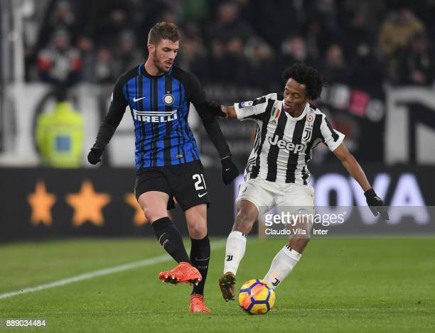 Davide Santon of FC Internazionale and Juan Cuadrado of Juventus FC compete for the ball during the Serie A match between Juventus and FC...