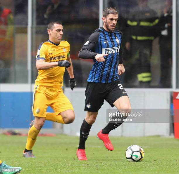 Davide Santon of Inter competes for the ball with Romulo during the serie A match between FC Internazionale and Hellas Verona FC at Stadio Giuseppe...