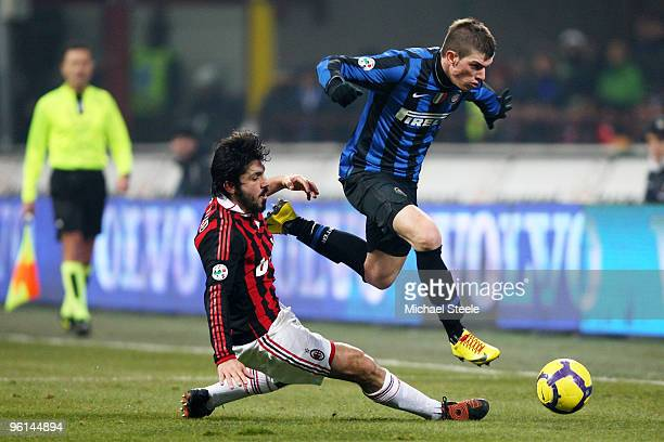Davide Santon of Inter leaps above the challenge of Gennaro Gattuso during the Serie A match between FC Internazionale Milano and AC Milan at Stadio...