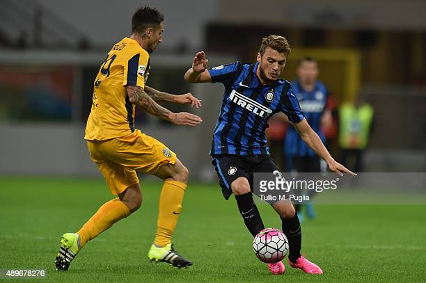 Davide Santon of Internazionale Milano and Leandro Greco of Hellas Verona compete for the ball during the Serie A match between FC Internazionale...