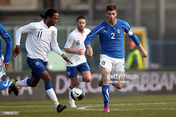 Davide Santon of Italy fights for the ball with Nathan Delfouneso of England during the international friendly match between Italy U21 and England...