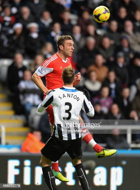 Davide Santon of Newcastle United challenges Ricky Lambert of Southampton during the Barclays Premier League match between Newcastle United and...