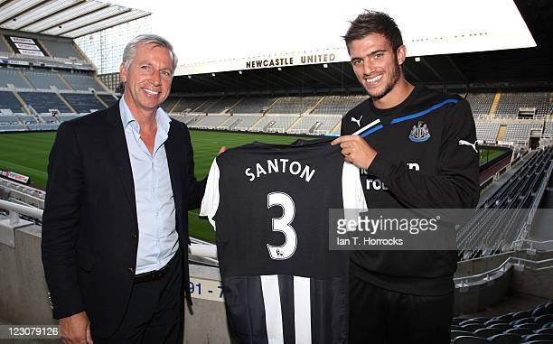 Davide Santon poses with manager Alan Pardew after signing for Newcastle United from Inter Milan at St James' Park on August 30, 2011 in Newcastle,...