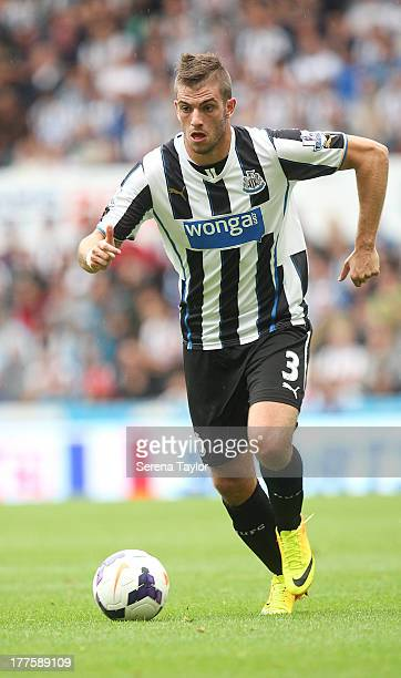 Davide Santon runs with the ball during the Barclays Premiership Match between Newcastle United and West Ham United at St James Park on August 24 in...