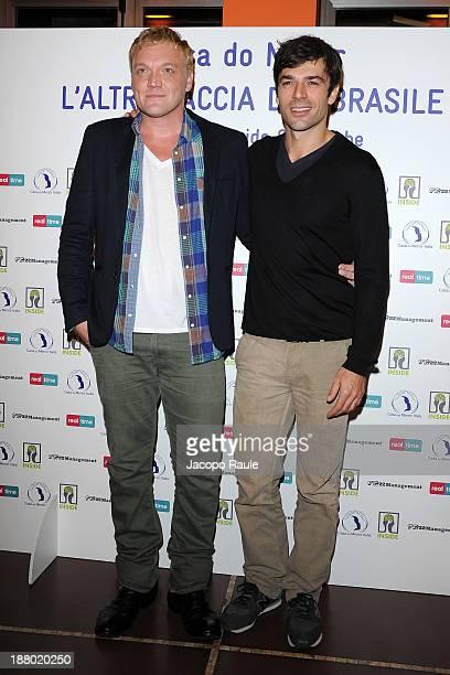 Davide Scalenghe and Luca Argentero attend 'Casa Do Menor L'altra Faccia Del Brasile' Milan Photocall on November 14 2013 in Milan Italy