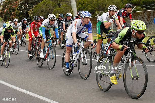 Davide Villella of Team CannnondaleGarmin gets into an areodynamic position during the Cadel Evans Ocean Road Race on February 1 2015 in Melbourne...