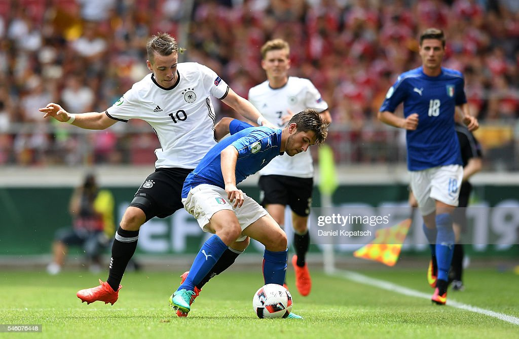 Davide Vitturini of Italy (R) is challenged by Max Besuschkow of Germany during the UEFA Under19 European Championship match between U19 Germany and U19 Italy at Mercedes-Benz Arena on July 11, 2016 in Stuttgart, Germany.