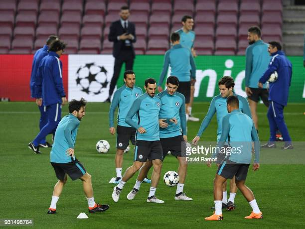 Davide Zappacosta and Alvaro Morata perform a drill with team mates during a Chelsea press conference on the eve of their UEFA Champions League round...