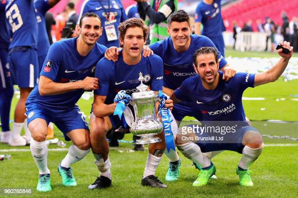 Davide Zappacosta Marcos Alonso Alvaro Morata and Cesc Fabregas all of Chelsea celebrate with the FA Cup trophy after the Emirates FA Cup Final...