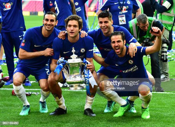Davide Zappacosta Marcos Alonso Alvaro Morata and Cesc Fabregas of Chelsea celebrate their victory with the Emirates FA Cup trophy following The...
