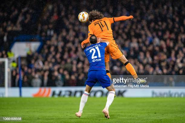 Davide Zappacosta of Chelsea and Amr Warda jump for ball during the UEFA Europa League Group L match between Chelsea and PAOK at Stamford Bridge on...