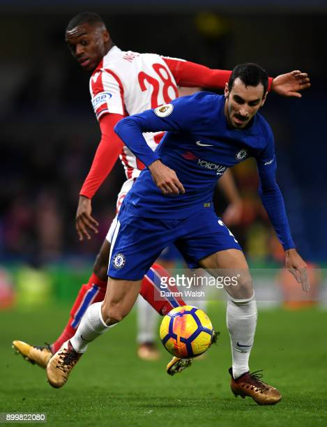 Davide Zappacosta of Chelsea and Julien Ngoy of Stoke City battle for possession during the Premier League match between Chelsea and Stoke City at...