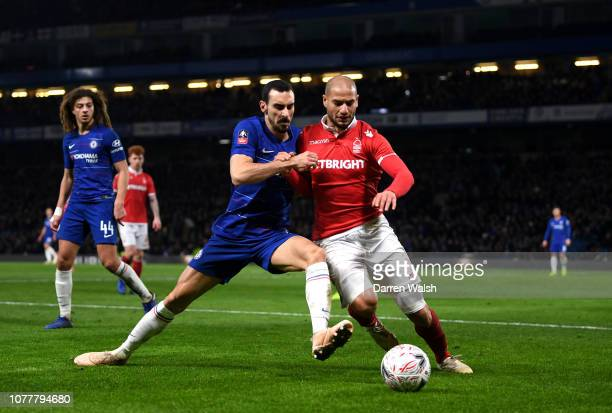 Davide Zappacosta of Chelsea battles for possession with Adlene Guedioura of Nottingham Forest during the FA Cup Third Round match between Chelsea...