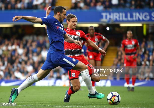 Davide Zappacosta of Chelsea battles for possession with Chris Lowe of Huddersfield Town during the Premier League match between Chelsea and...