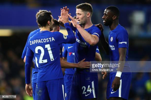 Davide Zappacosta of Chelsea celebrates scoring his side's fifth goal with teammate Gary Cahill during the Premier League match between Chelsea and...