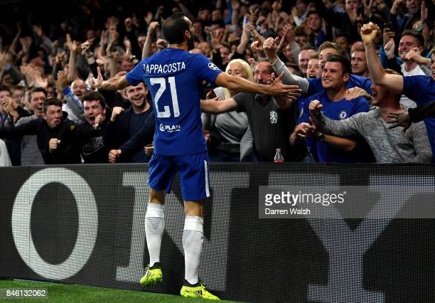 Davide Zappacosta of Chelsea celebrates scoring his sides second goal with the Chelsea fans during the UEFA Champions League Group C match between...
