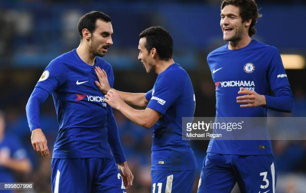 Davide Zappacosta of Chelsea celebrates with teammates Pedro and Marcos Alonso after scoring his sides fifth goal during the Premier League match...