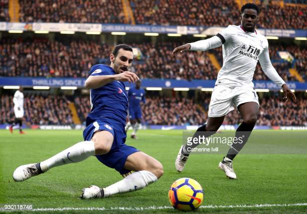 Davide Zappacosta of Chelsea clears the ball while under pressure from Jeffrey Schlupp of Crystal Palace during the Premier League match between...