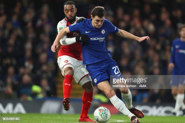 Davide Zappacosta of Chelsea competes with Alexandre Lacazette of Arsenal during the Carabao Cup SemiFinal first leg match between Chelsea and...