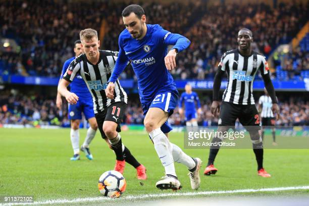 Davide Zappacosta of Chelsea in action with Matt Ritchie and Massadio Haidara of Newcastle United during the FA Cup 4th Round match between Chelsea...