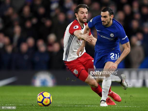 Davide Zappacosta of Chelsea is challenged by Jay Rodriguez of West Bromwich Albion during the Premier League match between Chelsea and West Bromwich...