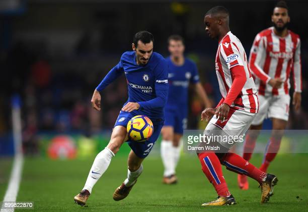 Davide Zappacosta of Chelsea is challenged by Julien Ngoy of Stoke City during the Premier League match between Chelsea and Stoke City at Stamford...