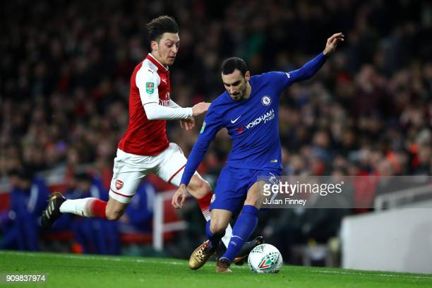 Davide Zappacosta of Chelsea is tackled by Mesut Ozil of Arsenal during the Carabao Cup SemiFinal Second Leg at Emirates Stadium on January 24 2018...
