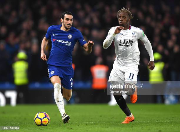 Davide Zappacosta of Chelsea runs with the ball under pressure from Wilfried Zaha of Crystal Palace during the Premier League match between Chelsea...