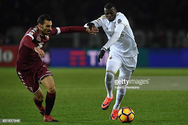 Davide Zappacosta of FC Torino competes with Mbaye Niang of AC Milan during the Serie A match between FC Torino and AC Milan at Stadio Olimpico di...