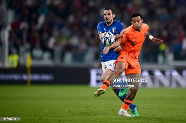 Davide Zappacosta of Italy and Memphis Depay of Netherlands compete for the ball during the International Friendly football match between Italy and...