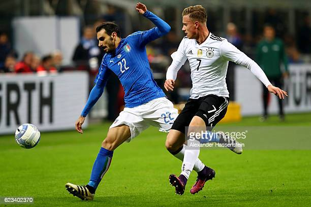 Davide Zappacosta of Italy and Yannick Gerhardt of Germany battle for the ball during the International Friendly Match between Italy and Germany at...