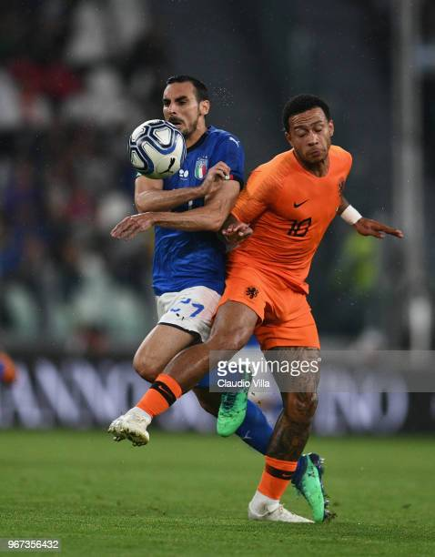 Davide Zappacosta of Italy competes for the ball with Memphis Depay of Netherlands during the International Friendly match between Italy and...