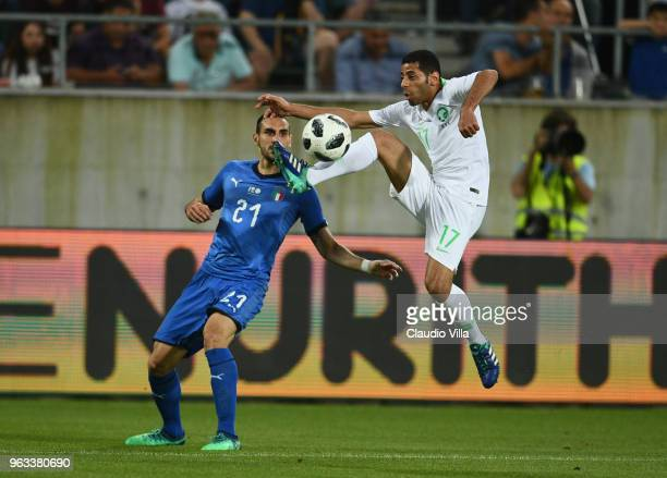 Davide Zappacosta of Italy competes for the ball with Taiseer Jaber Al Jassam of Saudi Arabia during the International Friendly match between Saudi...