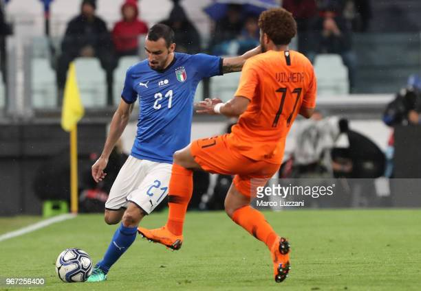 Davide Zappacosta of Italy competes for the ball with Tonny Vilhena of Netherlands during the International Friendly match between Italy and...