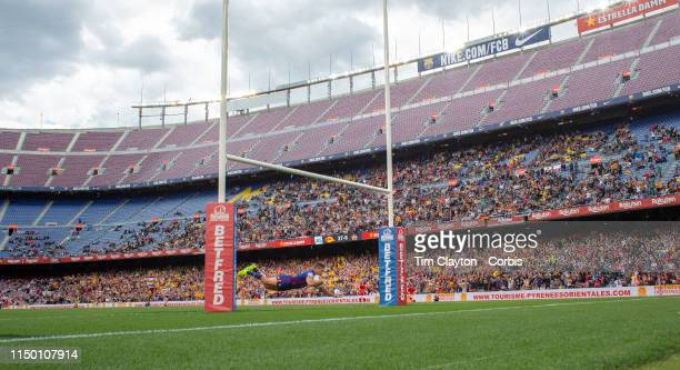 DavidMead of Catalans Dragons dives over between the posts to score a breakaway try during the Catalans Dragons V Wigan Warriors Betfred Super...
