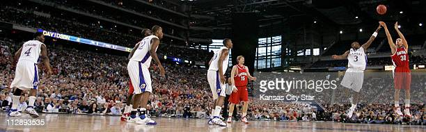 Davidson guard Stephen Curry fired a threepointer as Kansas guard Russell Robinson defends during first half action on Sunday March 30 2008 The...