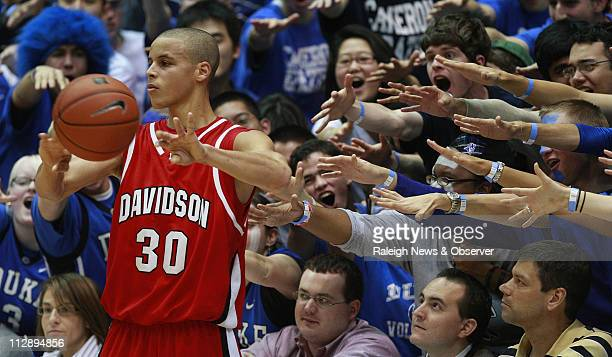 Davidson guard Stephen Curry is harassed by the Cameron Crazies during first half of action at Cameron Indoor Stadium in Durham, North Carolina,...