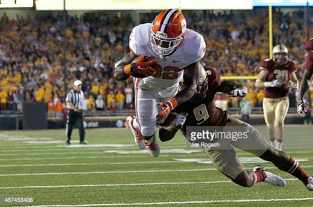 J Davidson of the Clemson Tigers scores the winning touchdown as Dominique Williams of the Boston College Eagles defends in the fourth quarter at...