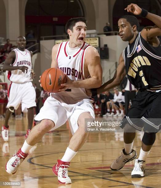 Davidson point guard Jason Richards tries to drive to the basket past Wofford's Drew Gibson during second half action at the Belk Arena in Davidson,...