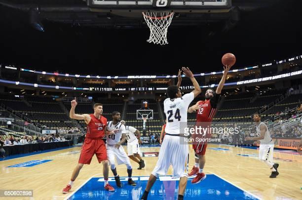Davidson Wildcats guard Jack Gibbs shoots the ball during an NCAA Atlantic 10 Championship game between La Salle Explorers and Davidson Wildcats on...