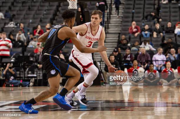 Davidson Wildcats guard Jon Axel Gudmundsson controls the ball during the first half of the Atlantic 10 Tournament semifinal round college basketball...