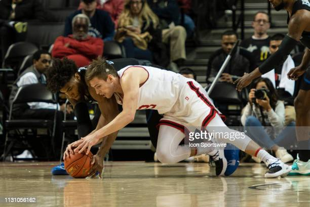 Davidson Wildcats Guard Jon Axel Gudmunsson and Saint Louis Billikens Forward Hasahn French compete for a loose ball during the first half of the...