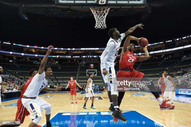 Davidson Wildcats guard KiShawn Pritchett tries to shoots the ball during an NCAA Atlantic 10 Championship game between La Salle Explorers and...