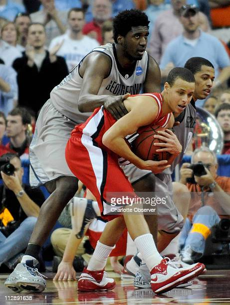 Davidson's Stephen Curry secures the rebound as Georgetown's Roy Hibbert and Jonathan Wallace are forced to foul late in second half action The...