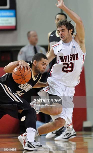 Davidson's Tom Droney right guards Vanderbilt's Jeffery Taylor Wednesday December 7 2011 in Davidson North Carolina