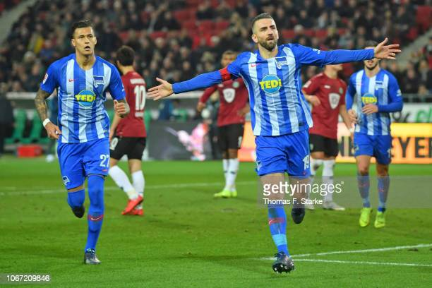 Davie Selke and Vedad Ibisevic of Berlin celebrate their teams second goal during the Bundesliga match between Hannover 96 and Hertha BSC at...