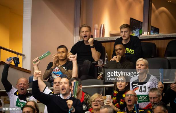 Davie Selke Arne Maier and Sinan Kurt of Hertha BSC during the handball world championship match between Germany and France at MercedesBenz Arena on...