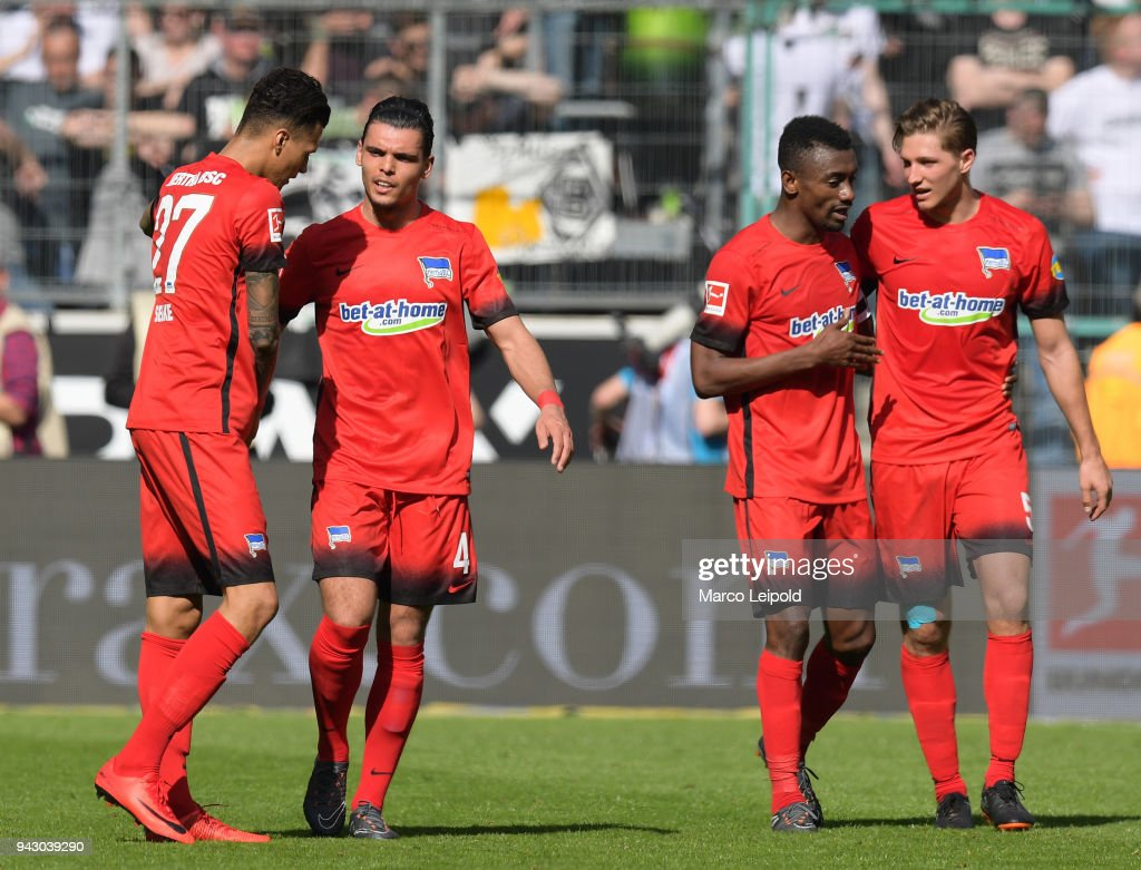Davie Selke, Karim Rekik, Salomon Kalou and Niklas Stark of Hertha BSC celebrate after scoring the 0:1 during the Bundesliga game between Borussia Moenchengladbach and Hertha BSC at Borussia Park Stadion on April 7, 2018 in Moenchengladbach, Germany.