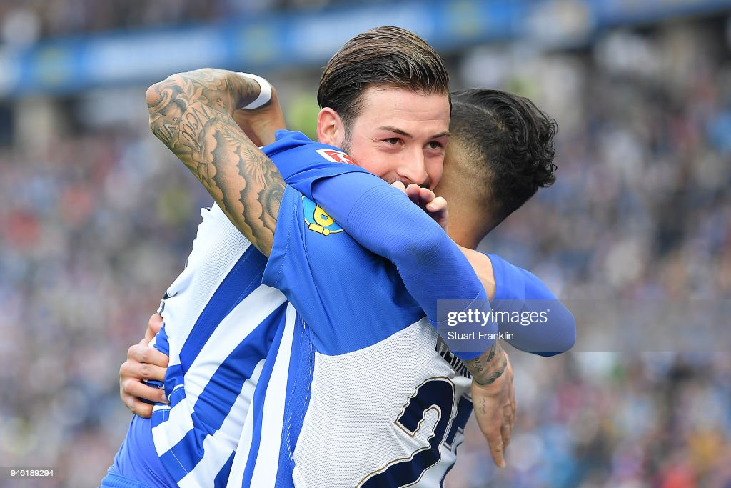 Davie Selke of Berlin (r) celebrates with Marvin Plattenhardt of Berlin after he scored a goal to make it 2:1 during the Bundesliga match between Hertha BSC and 1. FC Koeln at Olympiastadion on April 14, 2018 in Berlin, Germany.